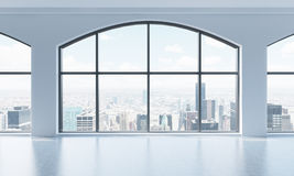 An empty modern bright and clean loft interior. Huge panoramic windows with New York city view. A concept of luxury open space for Stock Photos