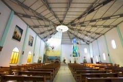 Empty modern church interior in the Galapagos Islands. PUERTO VILLAMIL, ECUADOR - FEBRUARY 13: Modern interior of the church in Puerto Villamil, Ecuador in the royalty free stock photos