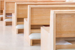 Empty modern church pews Stock Image