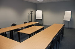 Empty modern classroom or meeting. Room with flip boards Royalty Free Stock Photography