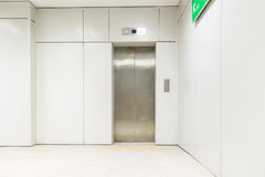 An empty modern elevator or lift with metal doors that are open Stock Photography