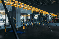 Empty modern sport center. Gym nobody. Fitness club interior Royalty Free Stock Photography