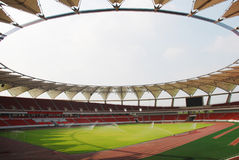 An empty modern stadium. In china,self-irrigators are spraying water Stock Images