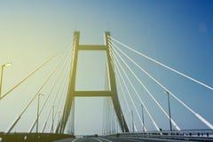 Empty bridge at sunrise with sun flare Royalty Free Stock Photo