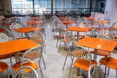 Empty modern style canteen with nobody using area. Silver shiny steel chairs and wooden tables in indoor industrial and modern style canteen - empty with nobody Stock Photography