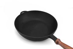 Empty Modern Vintage Cast Iron Pan With Wooden Handle Isolated stock photo