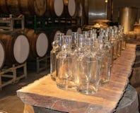 Empty Moonshine Bottles. A dozen plus bottles of moonshine bottles at the Three Boys Farm Distillery in Central Kentucky stock image