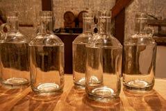 Empty Moonshine Bottles. A dozen plus bottles of moonshine bottles at the Three Boys Farm Distillery in Central Kentucky royalty free stock photography