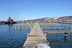 Empty mooring slips on Seneca Lake harbor during late winter. Showing the Seneca Lake dock after winter storm Stella. One of the Finger Lakes of New York State royalty free stock image