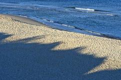 Empty  morning sea resort beach san with shadows Royalty Free Stock Photos