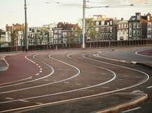 Empty morning street of Amsterdam city, before traffic on sunrise Royalty Free Stock Photos