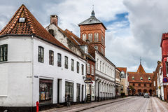 Empty morning street with old houses from royal town Ribe in Den Stock Photography