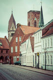 Empty morning street with old houses from royal town Ribe in Den Royalty Free Stock Photos