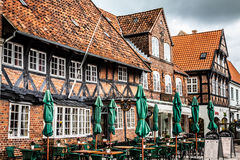 Empty morning street with old houses from royal town Ribe in Den stock photo