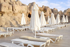 Empty morning sun beds by the pool Royalty Free Stock Photos