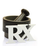 Empty mortar and pestle. With white wooden RX letters isolated Royalty Free Stock Photo
