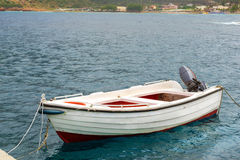 Empty motorboat drifting on waves in Bali, Crete Royalty Free Stock Photography