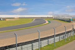 Empty motorsport race track. Shot of empty auto racing racetrack turn in summer sunny day royalty free stock images