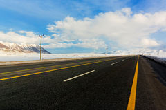 Empty motorway. And clouds meet in vanishing point royalty free stock photo