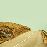 Empty mountain asphalt road and clear blue sky Stock Images