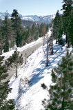 Empty Mountain Road. The view from a lift at Mammoth Mountain, CA of a empty road Royalty Free Stock Photos
