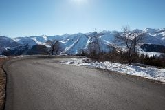 Empty mountain road with Alps view in a sunny day Stock Photography