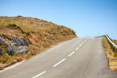 Empty mountain road and blue sky Stock Photography