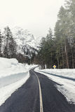 Empty mountain road on a cloudy winter day Royalty Free Stock Photography