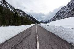 Empty mountain road on a cloudy winter day Stock Images