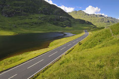 Empty mountain road in Scotland Stock Photos