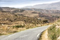 Empty Road Ireland 0010. Empty mountain road veering right, location west Kerry highlands off the Ring of Kerry, south west coast of Ireland Stock Photos