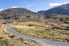 Empty Road Ireland 0011. Empty mountain road veering right, location west Kerry highlands off the Ring of Kerry, south west coast of Ireland Stock Images