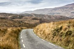 Empty Road Ireland 0013. Empty mountain road veering right, location west Kerry highlands off the Ring of Kerry, south west coast of Ireland Royalty Free Stock Images