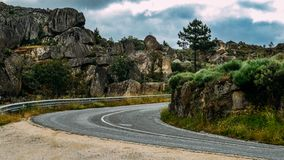 Empty mountanous road near the historic castle town of Sortelha in northeastern Portugal.  royalty free stock photography