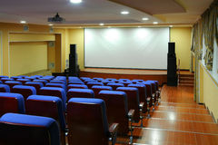 Empty movie theater. With a blank screen Royalty Free Stock Photography