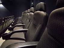 Empty movie theater. Dark modern stock photo