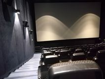 Empty movie theater. Dark modern royalty free stock photography