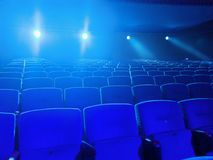 Empty movie theater with projection light falling into the lens Royalty Free Stock Photography