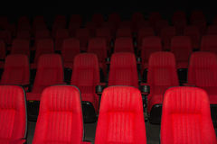 Empty movie theater with red seats Royalty Free Stock Photos
