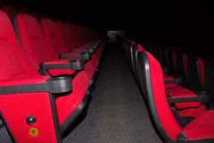 Empty movie theater with red seats Stock Photos