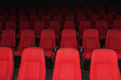 Empty movie theater with red seats Royalty Free Stock Image