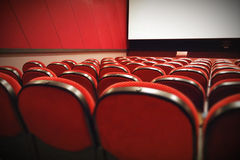 Empty movie theater with red seats Royalty Free Stock Photography