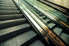 Empty moving escalator in underground railway station. Modern urban city life background Royalty Free Stock Photo