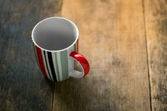Empty mug on wooden table