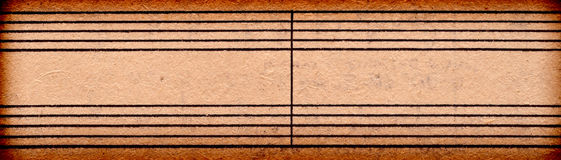 Empty music notes on old paper sheet Stock Images
