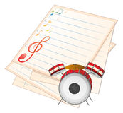 An empty music paper with a drum Stock Photo
