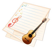 An empty music paper with a guitar Stock Photo