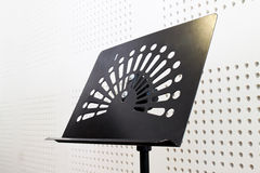 Empty music stand in soundproof room. One empty music stand in soundproof room Stock Photos