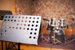 Empty music stand in studio Stock Images