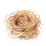 Empty Nest. Empty straw nest with twigs and feathers on a white background Stock Photography
